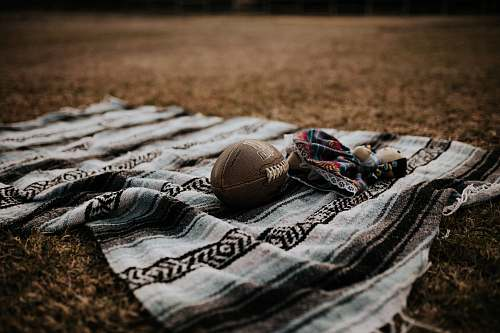 photo clothing brown football on grey textile sport free for commercial use images