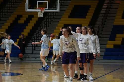 clothing group of girls playing basketball inside court shorts