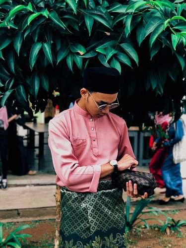 clothing man wears pink long-sleeved shirt human