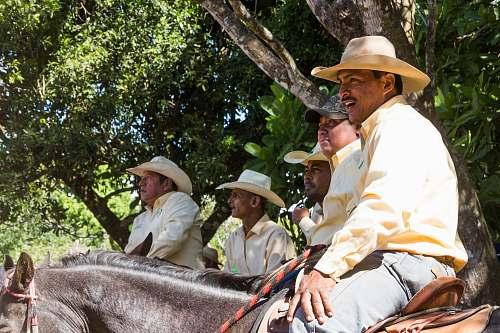 clothing men riding horses hat