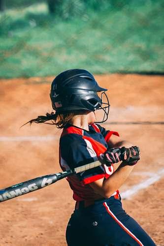 clothing person playing baseball helmet