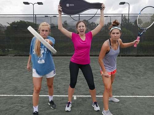 footwear three women holding tennis rackets shoe