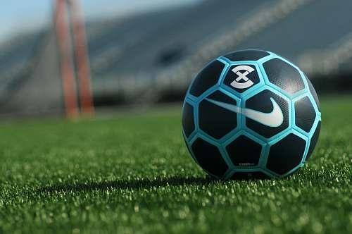 sphere black, blue, and white Soccer ball on grass field soccer