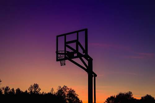 sky silhouette of basketball system sunset