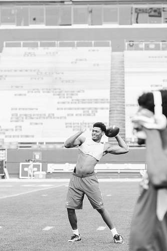 apparel grayscale photo of man playing football clothing