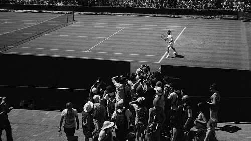 wimbledon grayscale photo of person playing tennis united kingdom