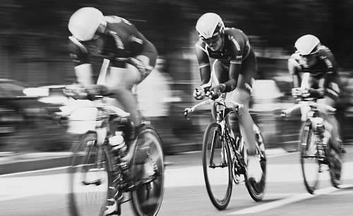 bicycle time lapse photography of three men cycling cyclist
