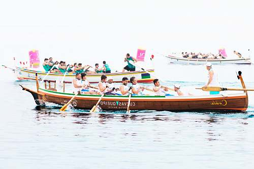 transportation group of people rowing boat vessel