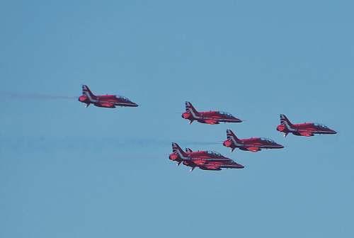 transportation five red-and-black fighter jets biplane