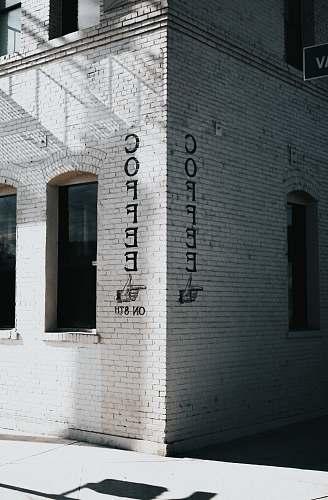 coffee white concrete brick building at daytime grey