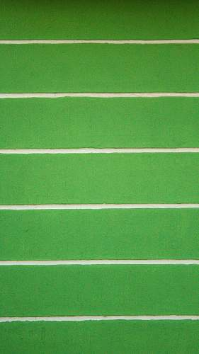 green green and white striped wall football