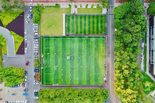 field top view photography green football field daji central street 2nd alley
