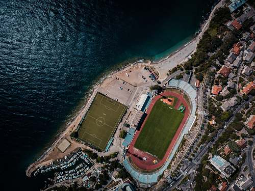 arena top view photography of buildings and body of water stadium