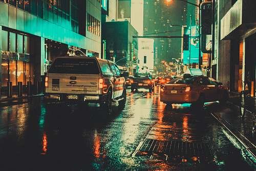 street white car on wet asphalt road urban