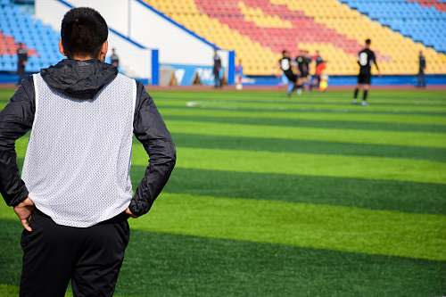 human person looking at soccer field person