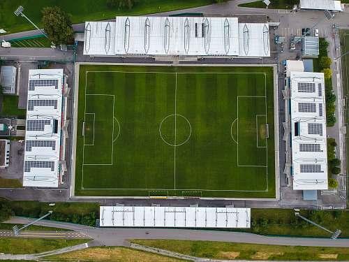 green soccer field building