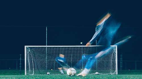 sport timelapse photo of soccer player kicking ball soccer