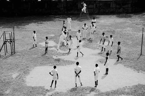 black-and-white group of people playing baseball chair
