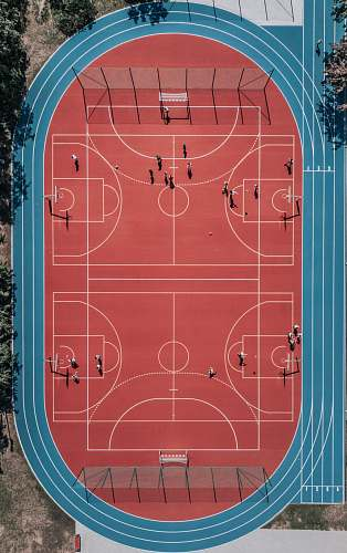 person aerial photo of basketball court red