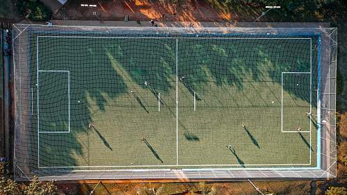 field aerial photo of soccer field people