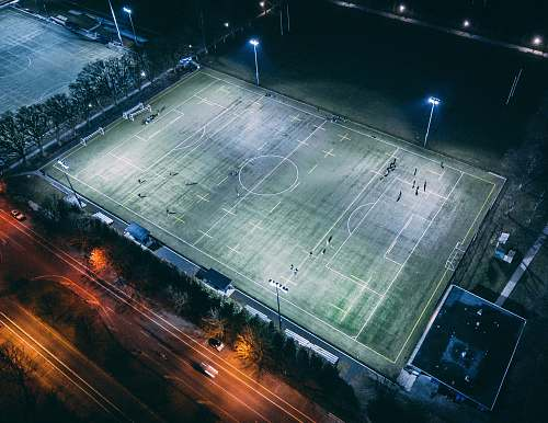people aerial photography of football field field