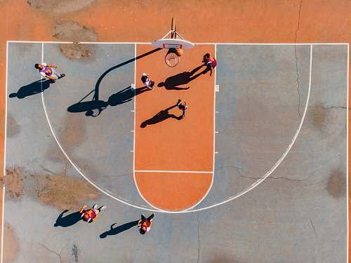 person aerial photography of men playing basketball people