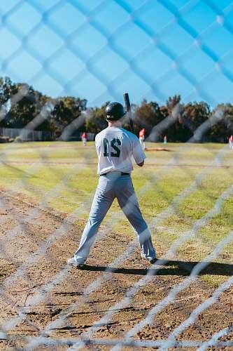 person baseball player near fence apparel