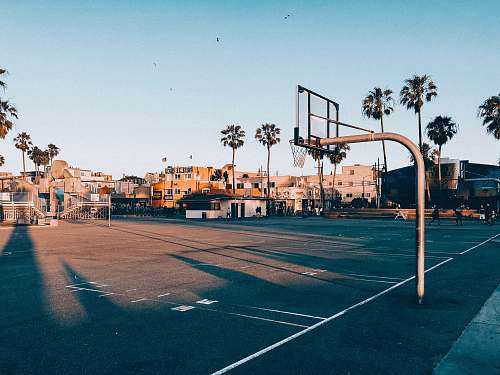 person basketball court during golden hour people