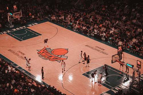 person basketball players playing on New York Knicks court people