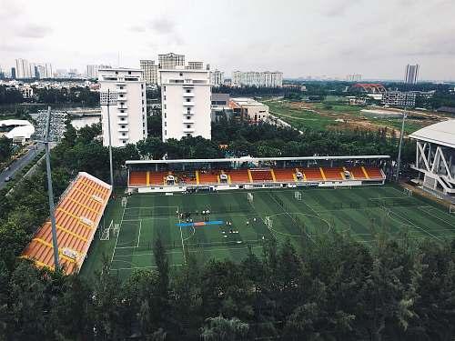 people bird's eye view of a green football field field