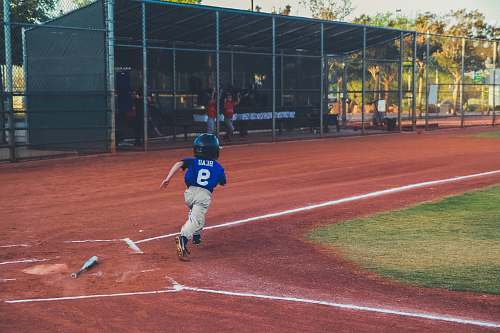 person boy hit the ball running for the next base people