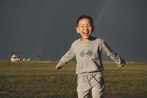 person boy on grass field boy