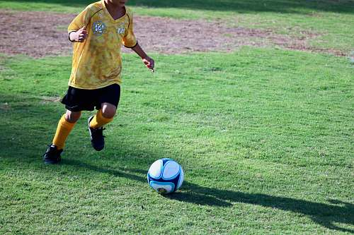 person boy playing soccer people