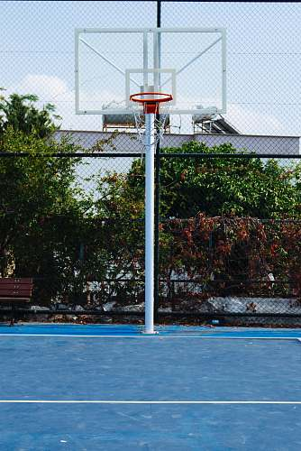 person empty basketball court during daytime people