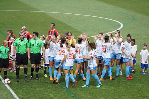 person female soccer team standing on field with officials and children people