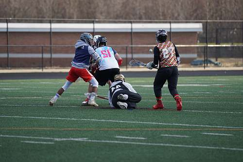 apparel four person playing lacrosse clothing