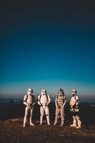person four person wearing Star Wars Clone Trooper costumes people