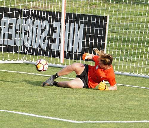 person goal keeper lying on grass people
