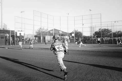 people grayscale photo of children playing baseball black-and-white