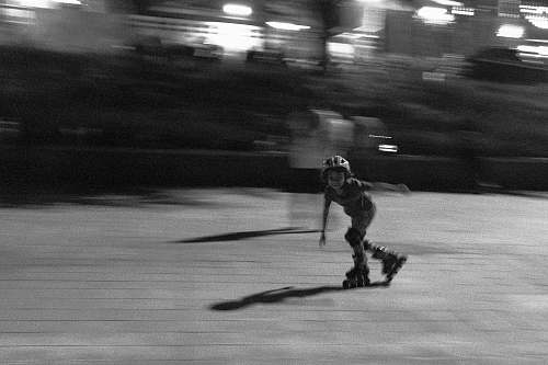 person grayscale photo of girl doing skate lines black-and-white