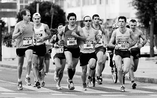 black-and-white grayscale photo of people performing marathon running