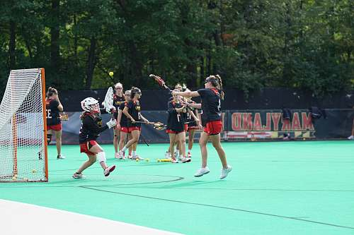 person group of girls playing lacrosse people