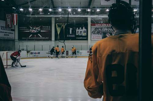 person group of men playing hockey people