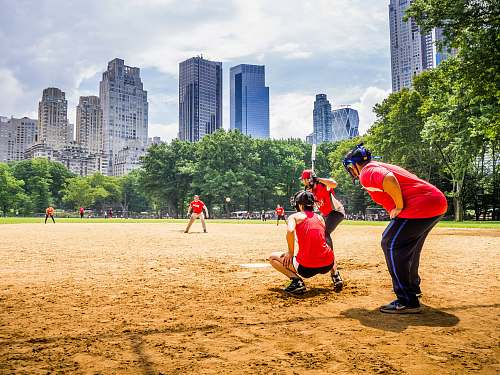 person group of people playing baseball at daytime sport