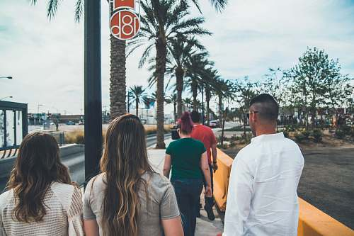 person group of people walking on a sidewalk las vegas