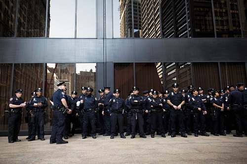 police group of police standing near grey building military