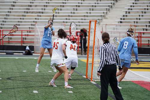people group of woman playing lacrosse game on field person