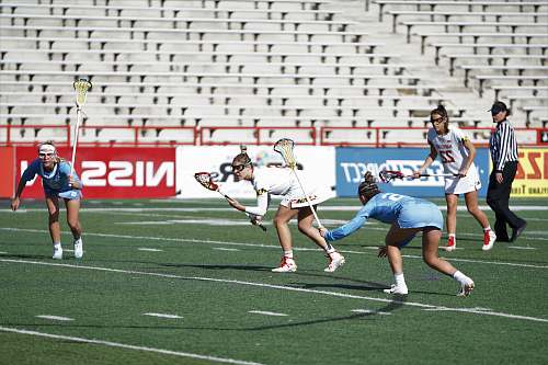 person group of women playing lacrosse on field apparel