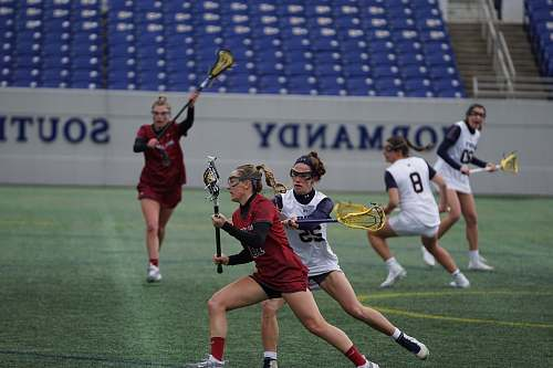 person group of women playing lacrosse people