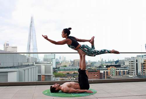 person man and woman doing yoga pose people